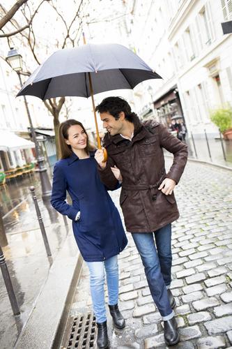 Happy smiling woman man umbrella shower